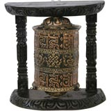 Prayer wheel, a cylinder of metal decorated with Buddhist mantras, designed to turn freely on its vertical axis
