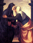 Mary telling the news to Elizabeth, who is clasping her hand and hugging her