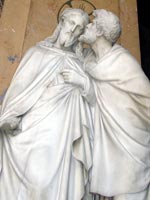 Statue of Judas betraying Jesus with a kiss