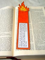 Bible with a bookmark shaped like a pillar of fire (depicting the image of the Holy Spirit in the story)