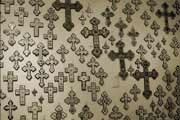 Wall covered with crosses in many different styles; photo by Kent Squires