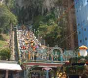 Pilgrims flock up the steps into the Batu Caves