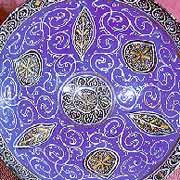 Gold and blue bowl with pattern of vine and leaf motifs