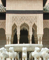 Court of the Lions, a paved space with a fountain surrounded by twelve lion statues, in Alhambra palace