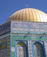 Gold dome and ornate blue and white pillared facade of Jerusalem's Dome of the Rock mosque