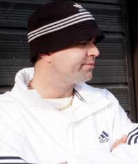 A man wearing a tracksuit and a gold chain