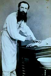 Surgeon pictured in USA c.1882, wearing an apron, but without surgical gloves or face mask