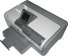 silver and white printer with small LCD screen