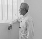 Nelson Mandela visiting his old prison cell on Robben Island.
