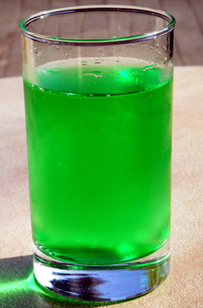 A glass of diabolo menthe - a bright green peppermint flavour soft drink