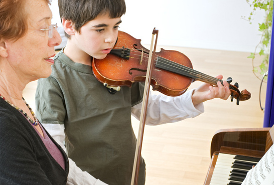 boy learning to play the violin