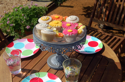 A table laid for a party with cake and lemonade