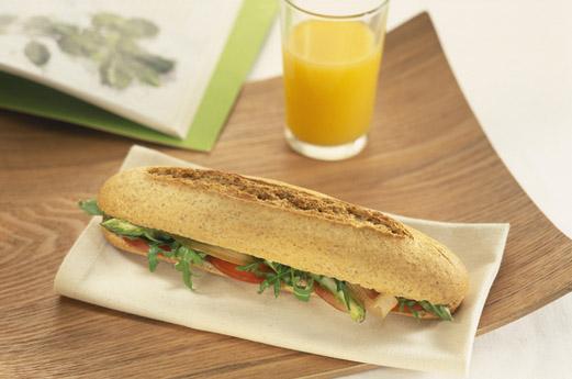 A baguette and orange juice