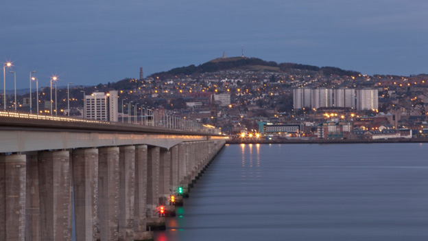 View along the Tay Bridge to Dundee, illuminated by lights from buildings and streetlights