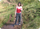 Julie McElroy using walking poles on 'The Whangie'