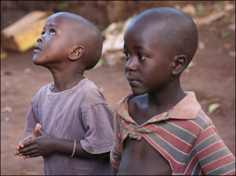 Photos for Africa. Two orphans in the slums of Kampala.