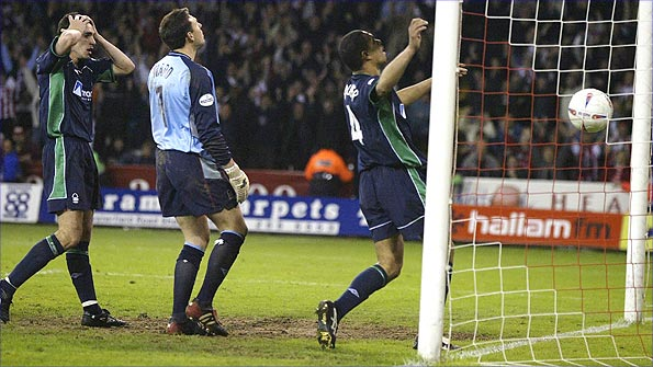 Des Walker (right) heads into his own net and Forest's Premier League dream ends in 2003 Photo: Getty