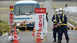 Police man a checkpoint in Fukushima Prefecture, Japan, about 20km (12-miles) from the tsunami-damaged Fukushima Daiichi nuclear power plant
