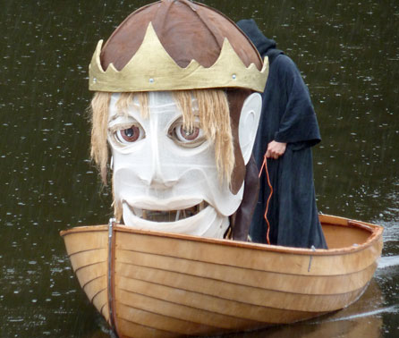 Image of the head of the Bran puppet in a boat. Image courtesy of Small World Theatre
