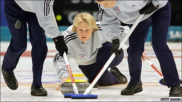 Rhona Martin watches on as Janice Rankin (left) and Fiona MacDonald sweep during Great Britain's curling gold medal success at the 2002 Olympics