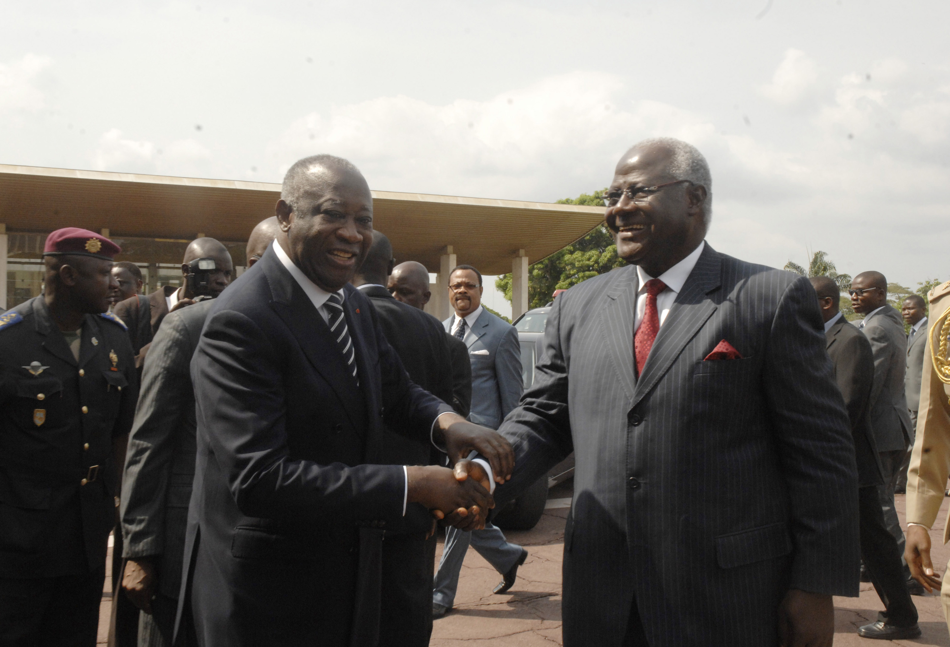 Ivory Coast incumbent president Laurent Gbagbo welcomes Sierra Leone President Ernest Bai Koroma, at the Presidential Palace in Abidjan, Ivory Coast, Tuesday, Dec. 28, 2010