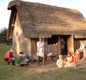 This is what an Anglo-Saxon house was like. The people are modern but wearing 'Anglo-Saxon' clothes.