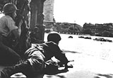 Two French soldiers in the shadow of the Arc de Triomphe, 1944
