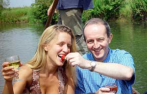 Helen with Huw, punting on the Cherwell