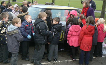 Pupils from Preston School, Stockton-on-Tees looking at the car
