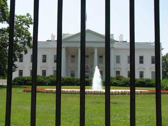 The White House, Washignton, seen through current security railings.