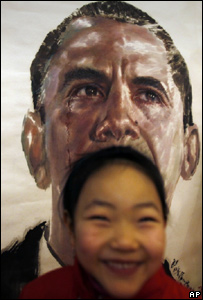 Chinese girl in front of Obama portrait