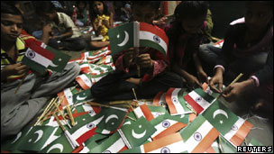 India and Pakistan flags being made to be handed over to cricket fans before the World Cup match between the two countries