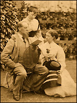 Charles Dickens the family man reading to one of his daughters and her companion.