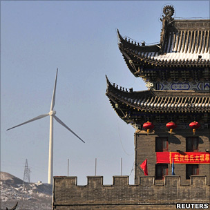 Wushu temple with wind turbine behind