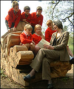 Carol Hughes with local schoolchildren