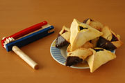 Wooden rattle and triangular cookies. Image © Howard Sandler/iStockphoto.com