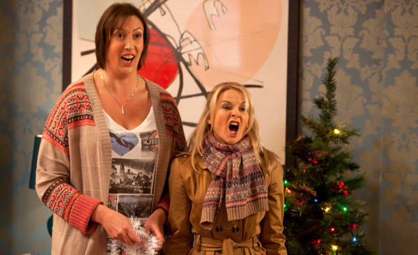 Miranda and Stevie belt out a carol.