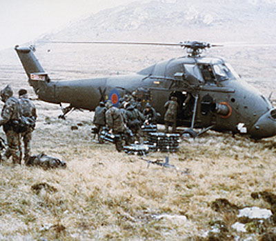 A Royal Navy Wessex 5 helicopter delivers mortar ammunition to the front line during mountain battles above Port Stanley