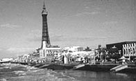 Black and white photograph showing the Blackpool Tower and sea front