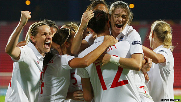 Jill Scott is mobbed by her team-mates after scoring England's winner in the European Championship semi-final