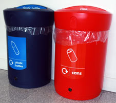 2 recycling bins, one for plastic bottles and one for cans