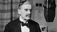 Neville Chamberlain conducts a radio broadcast on the BBC