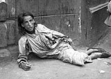 Starving woman in the Warsaw ghetto