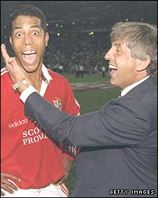 Ian McGeechan celebrates the 1997 Lions series victory in South Africa with Jeremy Guscott