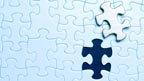 A jigsaw puzzle with a piece taken out