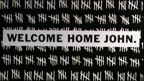 "A poster saying ""welcome home John"" after the release of Beirut hostage John Mccarthy"