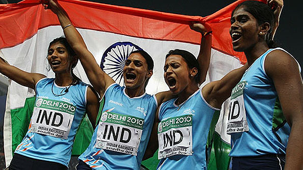 India's victorious women's 4x400m quartet celebrate their country's first Commonwealth track title since 1958.