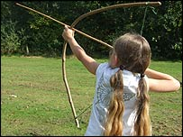 Girl firing a bow and arrow