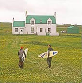 people with surfboards on Tiree
