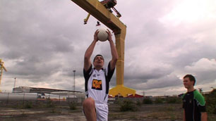 Footballer doing the high catch at Titanic Quarter